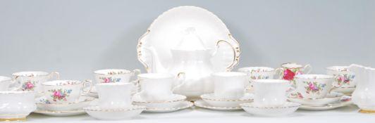 A vintage Royal Albert Val D'or pattern part tea service consisting of tea pot, tea cups, saucers,