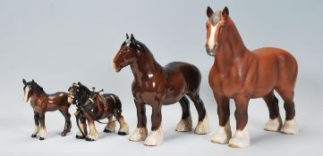 A group of Beswick ceramic horses to include a mat