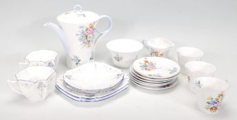 A mid 20th Century Shelleyporcelain part coffee service painted with floral sprays having shaped