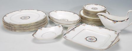 A Wedgwood Bone China dinner service in the Osborne R 4699 pattern, consisting of eight dinner