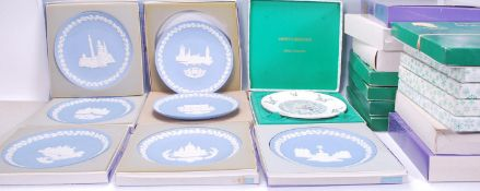 A collection of 20th Century christmas plates of varying sizes and designs. The plates consisting of
