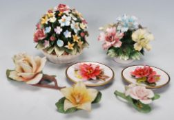A group of vintage 20th Century Capodimonte ceramic flower ornaments of varying colours, two
