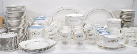 An extensive Royal Doulton ' Pastorale ' dinner service comprising cups, saucers, plates, meat