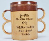 A 19th Century Victorian Doulton Lambeth stoneware loving cup having two graduating sets of twin