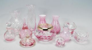 A good collection of 20th Century Caithness glassware, mostly pink in colour to include a matching