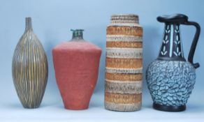 A collection of vintage retro art pottery to include a West German vase having banded decoration,