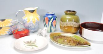 A mix group of Poole Pottery ceramic wares dating from the mid Century to include a jug and bowl