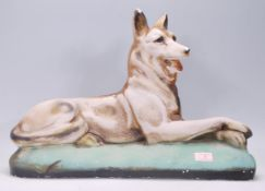 An early 20th century / 1930's Art Deco fairground prize in chalkware depicting and Alsatian dog
