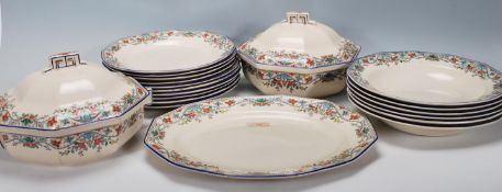 A Royal Doulton Draycott pattern Art Deco dinner service comprising dinner plates, side plates, meat