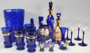 A good collection of 20th Century blue glassware to include a large blue glass vase, decanters,