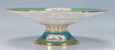 A 19th Century French style centrepiece tazza having a green ground with panels of hand painted