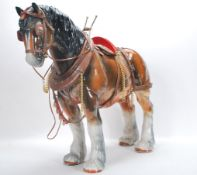 A large vintage 20th Century ceramic figure ornament of a shire horse in the manor of Beswick having