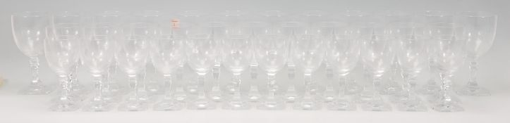 A collection of vintage 20th Century crystal glasses, the set to include 12 red wine glasses, 11