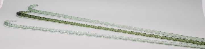 A group of three19th Century Victorian Nailsea glass walking sticks. Each walking stick of
