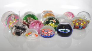 A large collection of 20th century paper weights, to include multi colour floral examples, control