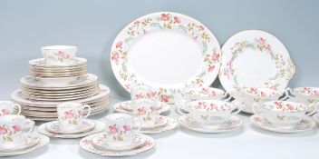 A vintage 20th Century Duffield Derbyshire 'Abbeydale' pattern bone china dinner service having a