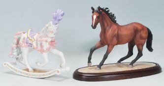 """A Brooks & Bentley Thoroughbred """"Champion of the wind"""" horse figure raised on a wooden plinth"""