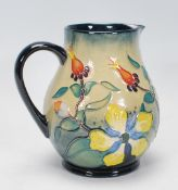 A Moorcroft jug of bulbous form in theHypericum pattern, designed by Rachel Bishop. The jug with