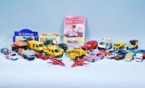 A collection of vintage diecast toy cars and vehic