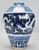 A 19th Century Chinese earthenware vase of taperin