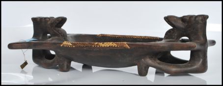 A 20th Century carved African hardwood tribal tray