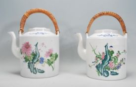 A pair of large Chinese polychrome teapots of cyli
