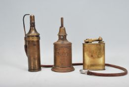 A small group of early 20th Century brass oil lamp