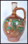 A 20th Century studio pottery ewer jug of bulbous
