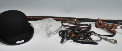 A collection of horse riding equipment to include