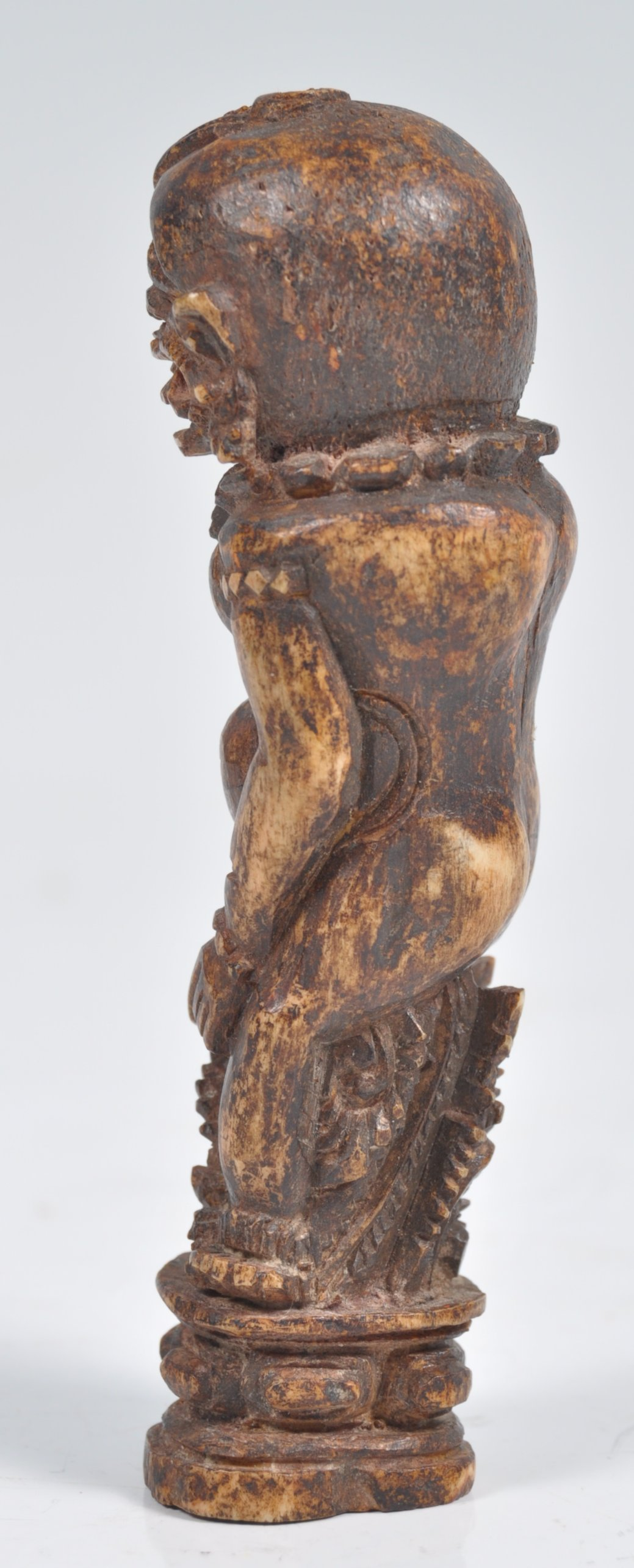 Lot 195 - UNUSUAL INDONESIAN CARVED BONE SCULPTURE OF AN ANCIENT DEITY