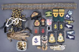 A collection of assorted military and Royal Navy uniform patches and accessories to include a
