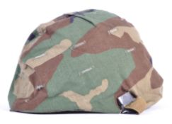 UNIFORMS AND FANCY DRESS - A BRITISH ARMY HELMET WITH CAMOUFLAGE COVER.