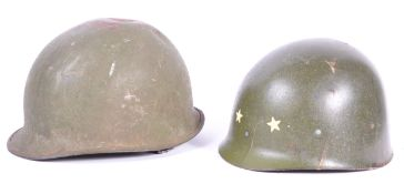 UNIFORMS AND FANCY DRESS - A PAIR OF METAL POST WWII AMERICAN COMBAT HELMETS.