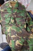 UNIFORMS & FANCY DRESS - A COLLECTION OF CAMOUFLAGE COMBAT JACKETS AND A HAT.