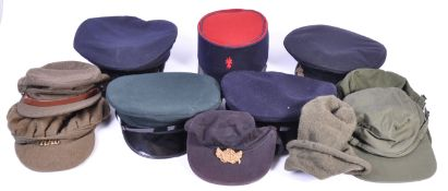 UNIFORMS AND FANCY DRESS - A COLECTION OF ASSORTED MILITARY RELATED HATS.
