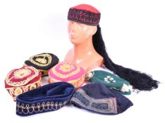 UNIFORMS AND FANCY DRESS - A COLLECTION OF SEVEN TURKISH TAQIYAH FEZ CAPS.
