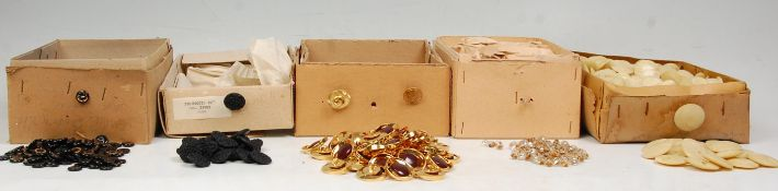 A incredible collection of mid 20th century circa 1950's plastic, glass, and metal buttons to