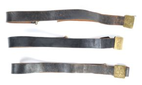 UNIFORM AND FANCY DRESS - A GROUP OF THREE LEATHER MILITARY STYLE BELTS.