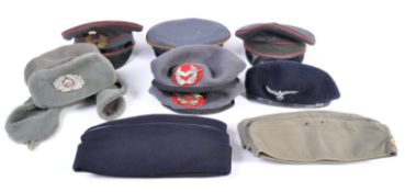 Fancy dress - A collection of eight 20th post WWII genuine military and air force hats and berets,