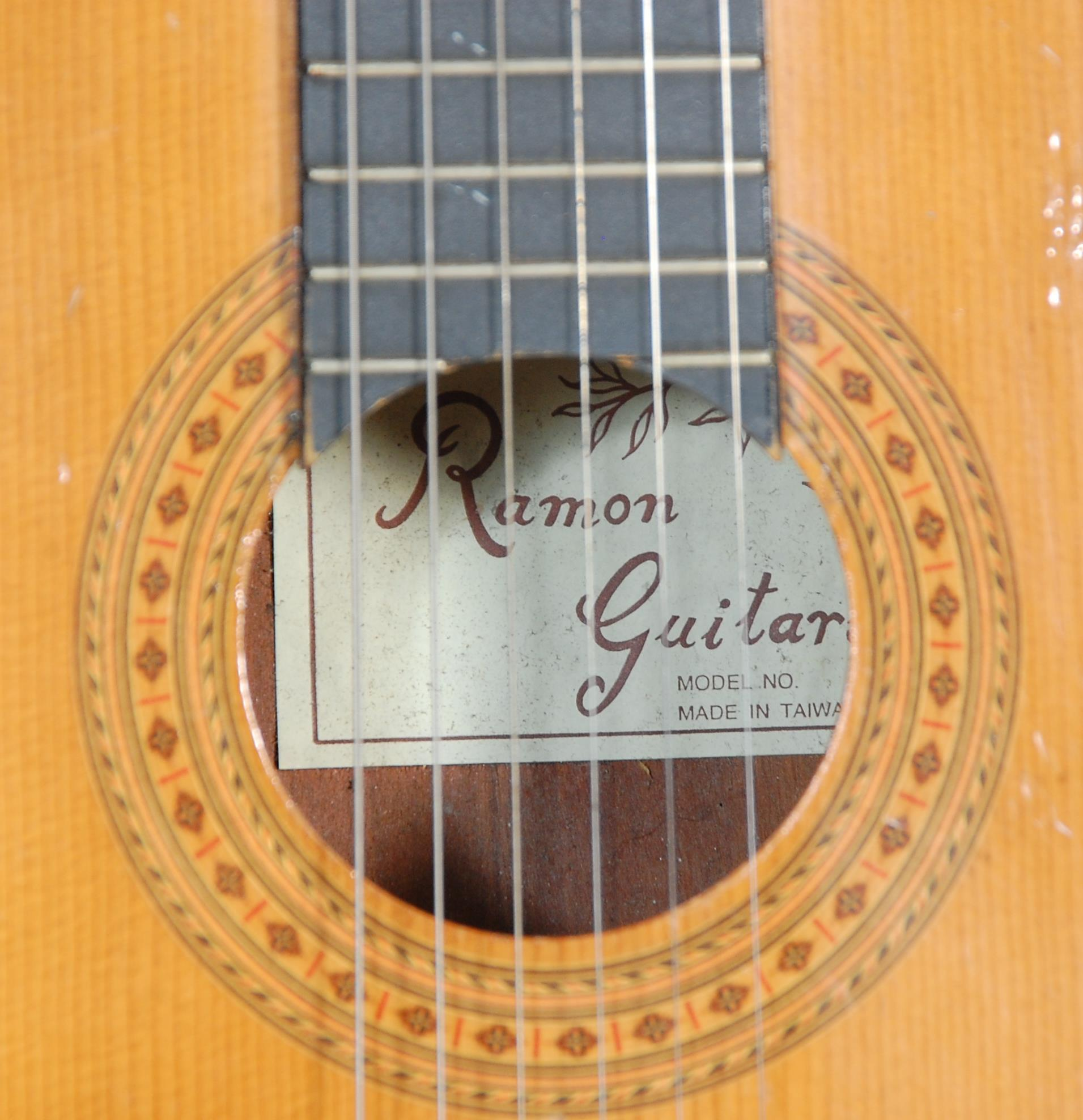 Lot 476 - A vintage Ramon made six string acoustic guitar having inlaid decoration. Paper label to inner for