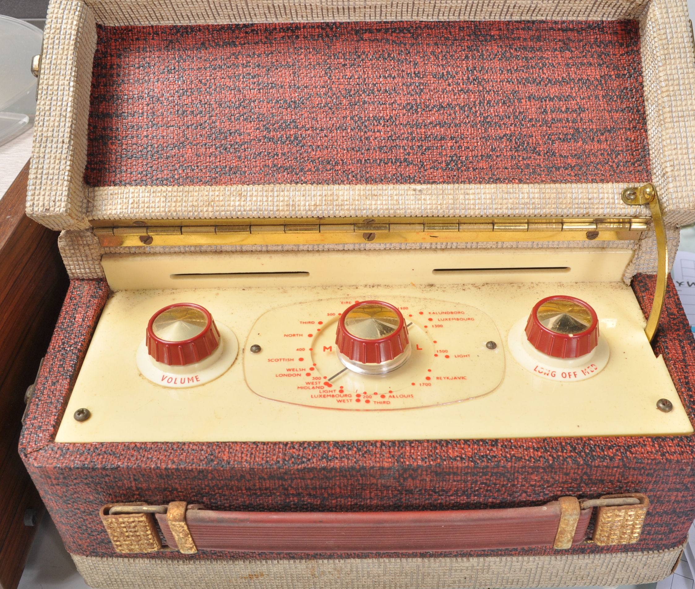 Lot 475 - A vintage 20th Century Dansette Major two tone portable record player, carry handle to side, lift up