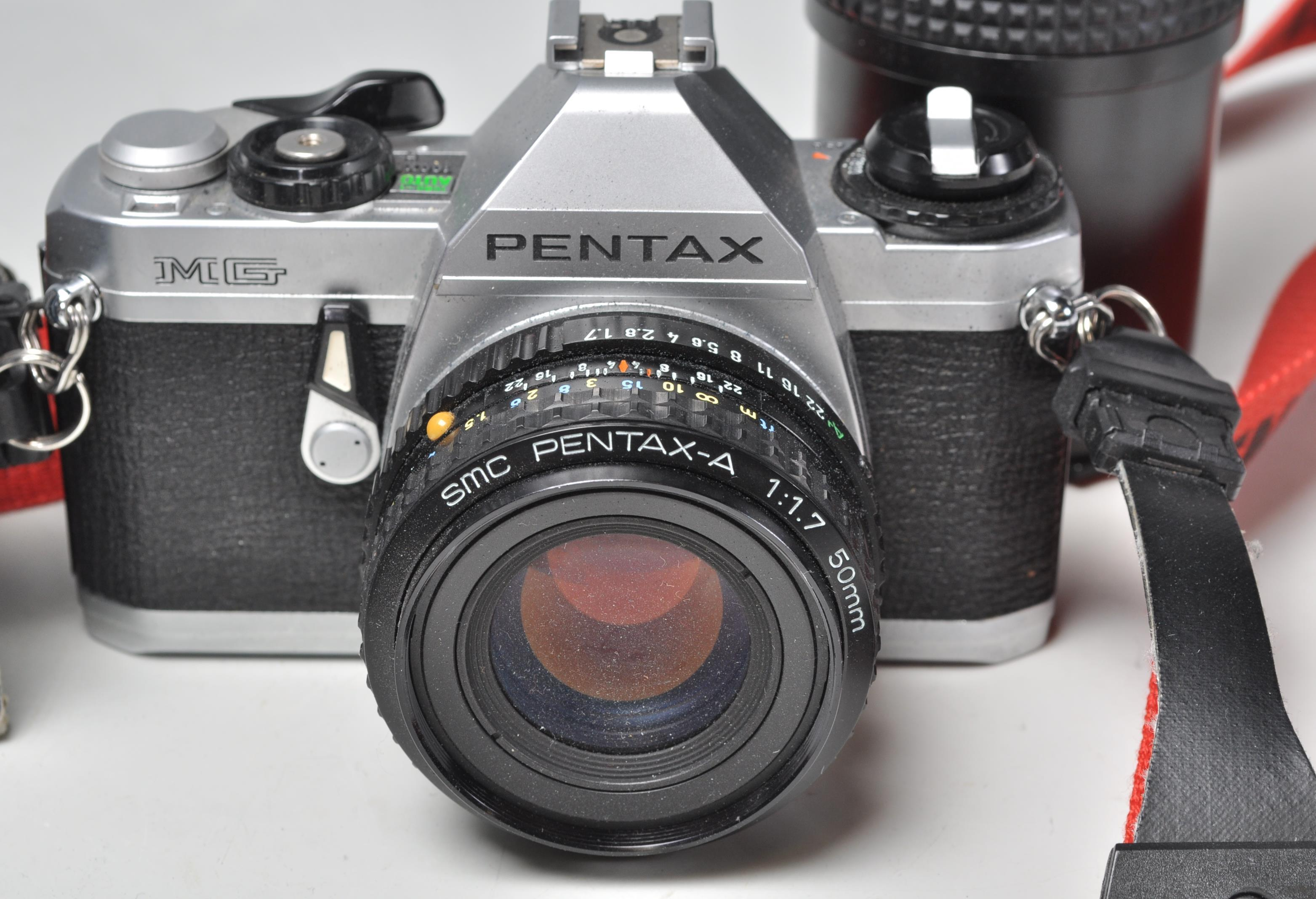 Lot 315 - A Pentax MG SLR film camera with a Pentax-A 50mm lens, a Bell & Howell Skylight 52mm lens, Vivitar