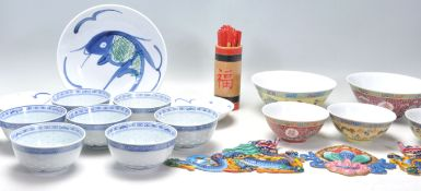 A collection of 20th Century Chinese / Japanese blue and white rice bowls with floral and plantain