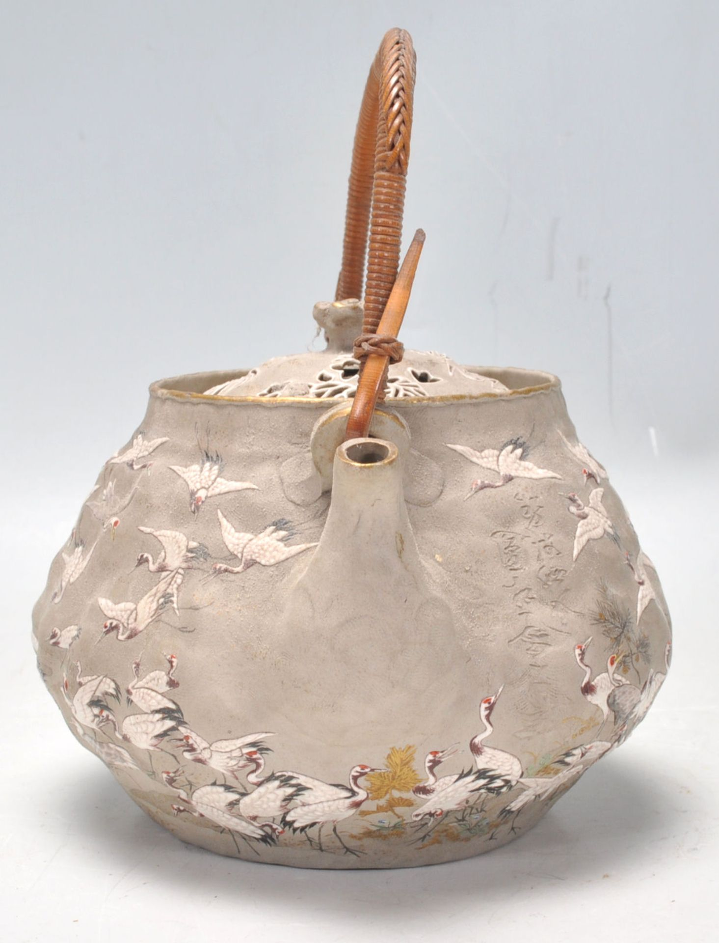 Los 148 - An unusual Chinese hand painted terracotta teapot being decorated with a grey ground highly...