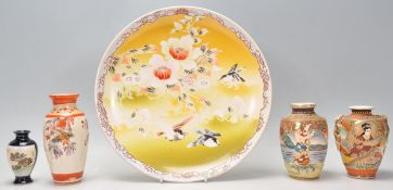A mixed group of Japanese ceramics dating from the early 20th Century to include a hand decorated