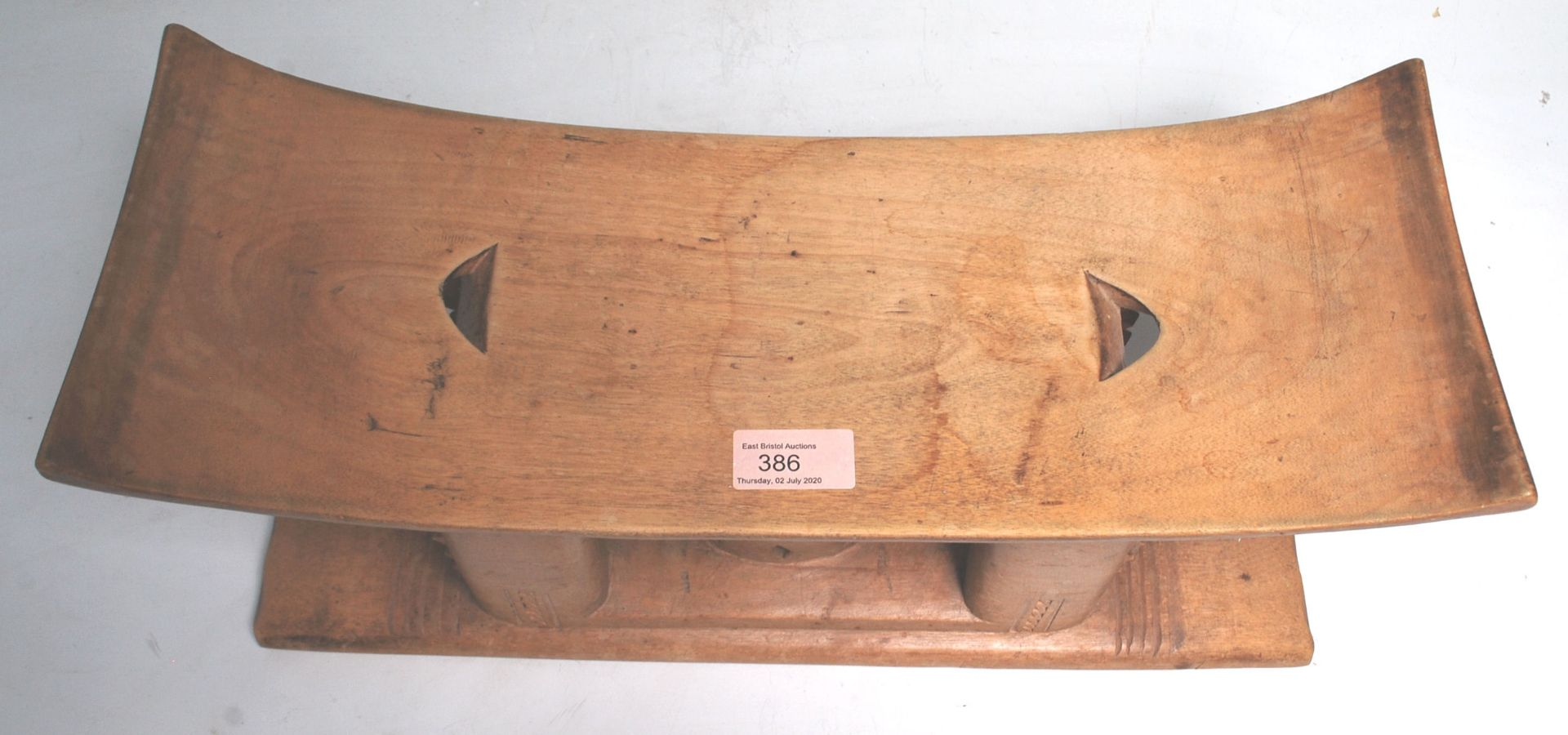 Los 386 - A carved African tribal Akan / Asante Ghanaian anthropomorphic stool having a rectangular curved...