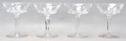 A set of four vintage Waterford crystal cut glass champagne / cocktail glasses having wide faceted