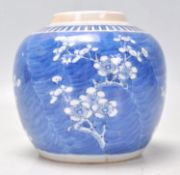 A 19th Century Chinese ginger jar hand painted in the prunus pattern with a key border to the top