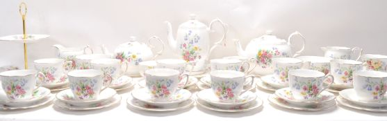 A Fine Bone China English tea service by Queen Anne China in the Old Country Spray pattern having