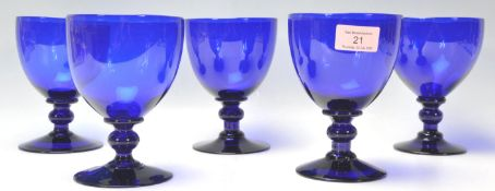 A set of five vintage 20th Century large cobalt blue glass wine glasses / rummers having round bowls